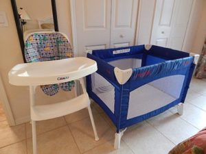 Crib and high chair in Our Disney Place in Bahama Bay, Florida